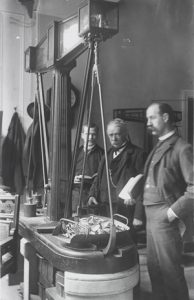 Weighing of silver, circa 1888