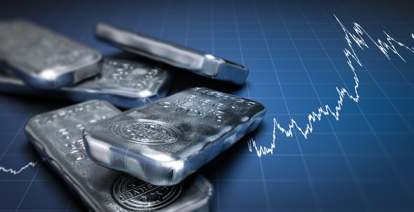 Silver bars with stock ticker background