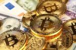 Bitcoins sitting atop paper money