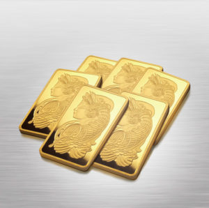 Stack of gold bars on mirrored background