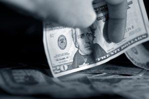 Money in Hand - Twenty American Dollars in Man's Hand
