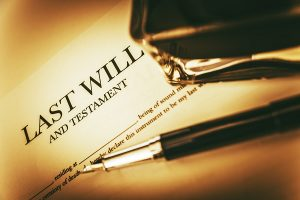 Last Will Concept Photo. Last Will Testament, Ink Bottle and Fountain Pen Concept.