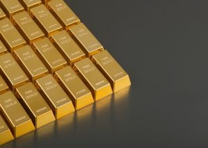 Rows of gold bars on a dark grey background